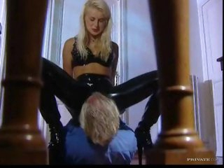 Chick in latex panties sits on his face