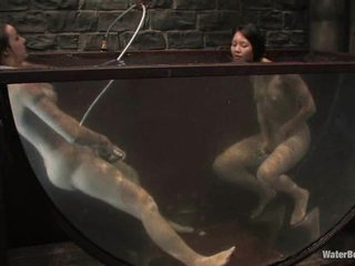 Twisted, nasty sluts fuck each other in an exotic underwater scene