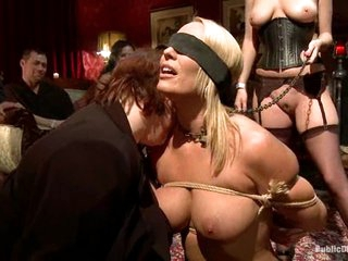Obedient slave Mellanie Monroe is put on display at a party.