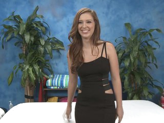 Maddy is the next wonderful massage girl. She wears beautiful smile and sexy black dress. She loves to pose for the camera in the massage room before action begins.