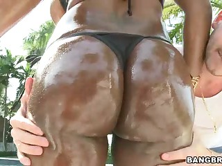 Wet dark sinned porn diva Jada Fire in black bikini shows her assets to lucky white guy by the pool. She exposes her big butt and massive tits before taking his white dick in her mouth.