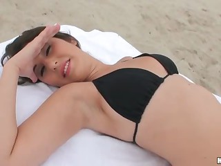 Missi Daniels in sexy black bikini gets picked up on Miami beach. She makes her playful eyes on camera as she gives good blowjob from young [respective./