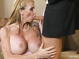 Middle aged blonde Taylor Wane with massive fake boobs lures gentleman into fucking. She bares her bombs and deepthroats his cock to get him ready to drill her thirsty mature pussy.