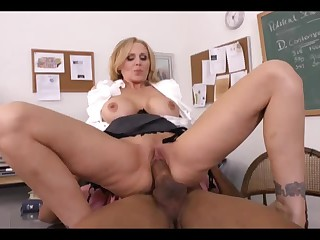 Four-eyed black guy finds his chocolate cock in hot mouth and then pussy of well-endowed milf teacher Julia Ann. She shows her slutty side to dark skinned guy.