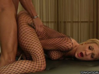 Big boobed blond porn star Amy Brooke wear black fishnet body stocking for rich man. She satisfies his sexual needs giving her pussy doggy style and sucking his dick.