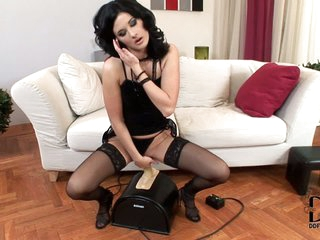 Lulu finds Sybian machine amazing and gives it a try. She's a lovely stocking-clad babe in black that rubs her pussy before riding her new sex machine with passion.
