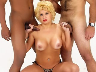 A sexy blonde MILF named Amanda came to us for her cock fix and here she got it from two studly bisexual guys. In this scene, two muscled guys enjoy pounding each other's butts and gave this horny MILF a go and crammed her mouth with revved up shafts.