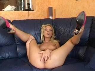 Golden-Haired Nympho Engulfing A Vibrator