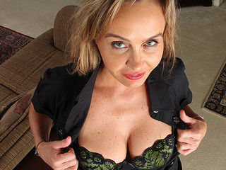 Hot milf harpy is exposing her fine boobs on camera