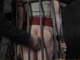Dirty slave in the cage looks noxious while she is treated badly