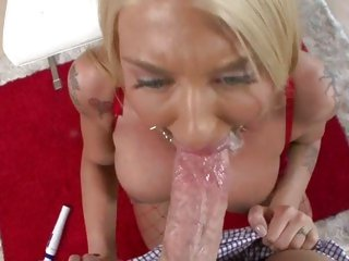 Tattooed blonde gobbles down a stiff fuck shaft