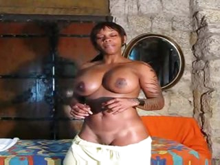 Fit darksome girl poses solo and talks to you