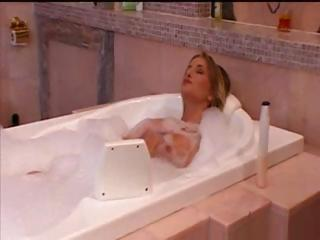 Golden-haired Sarah takes a bath and gets dressed to go out and fuck