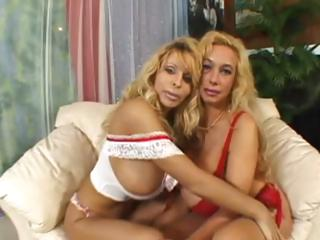 Two horny blonde lesbos caressing the massive tits and fucking with a double dildo