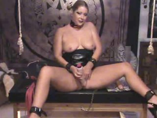 In her personal dungeon toying her pussy